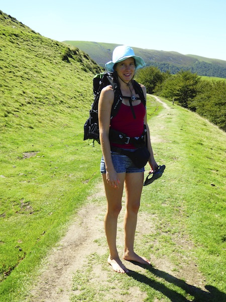 A girl walked barefoot in Pyrenees.