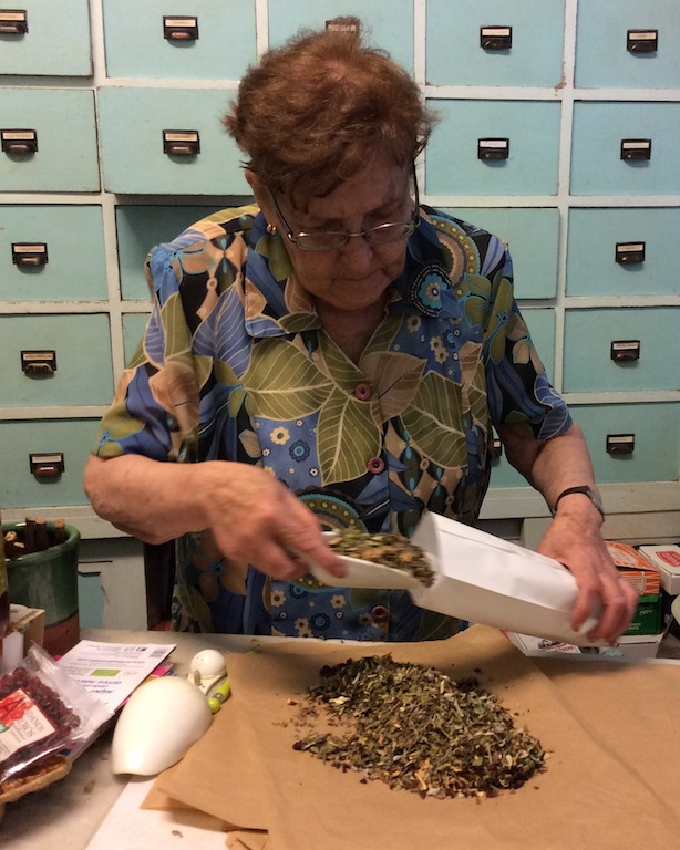 This woman is mixing herbs.
