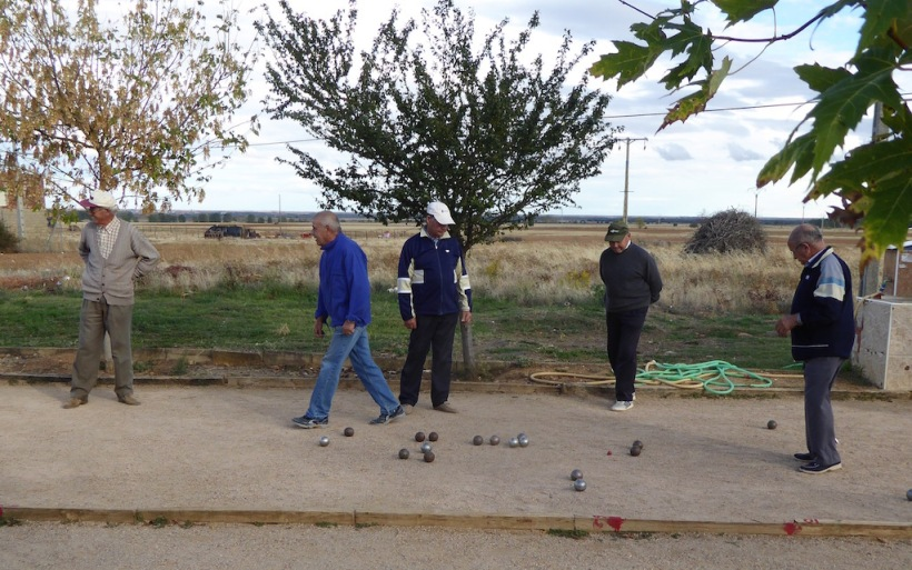 Men are playing bocce ball.