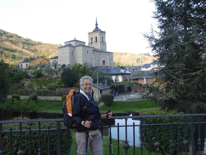 Nancy standing near a church in Reigo de Ambros.