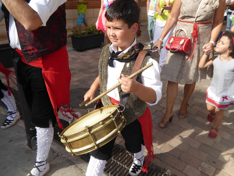 A young boy played in the parade in Belorado.