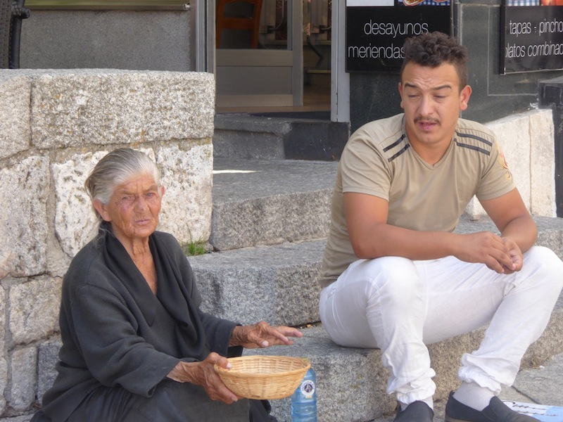 There was a woman begging in the plaza in Burgos.