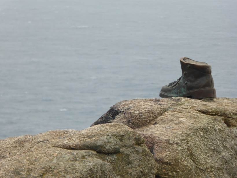 Photo of book on rock left in Finisterre.