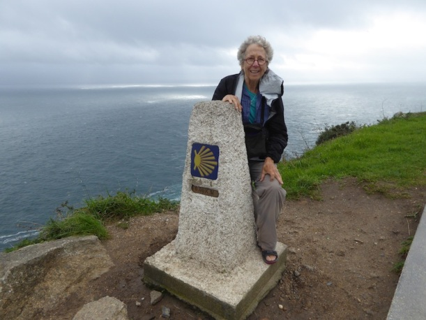 Nancy is standing by the zero marker in Finisterre.