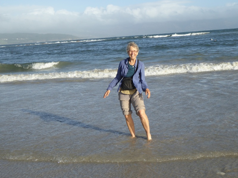Nancy putting her feet into the Atlantic in Finisterre.