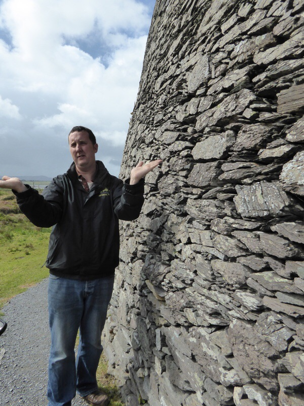 Here is Muiris by the stone wall.