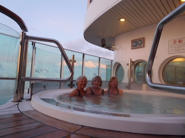 They are enjoying the hot tub on the ship.