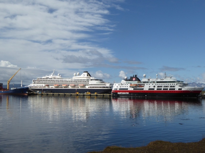 This is a photo of the MS FRAM next to a larger cruise ship.