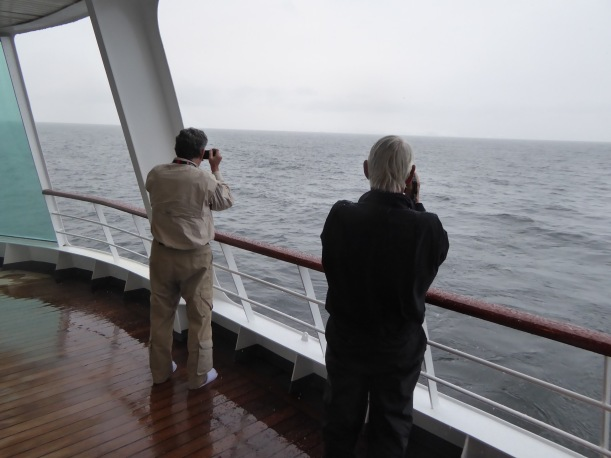 Fred and Bill are trying to get photos of whales.