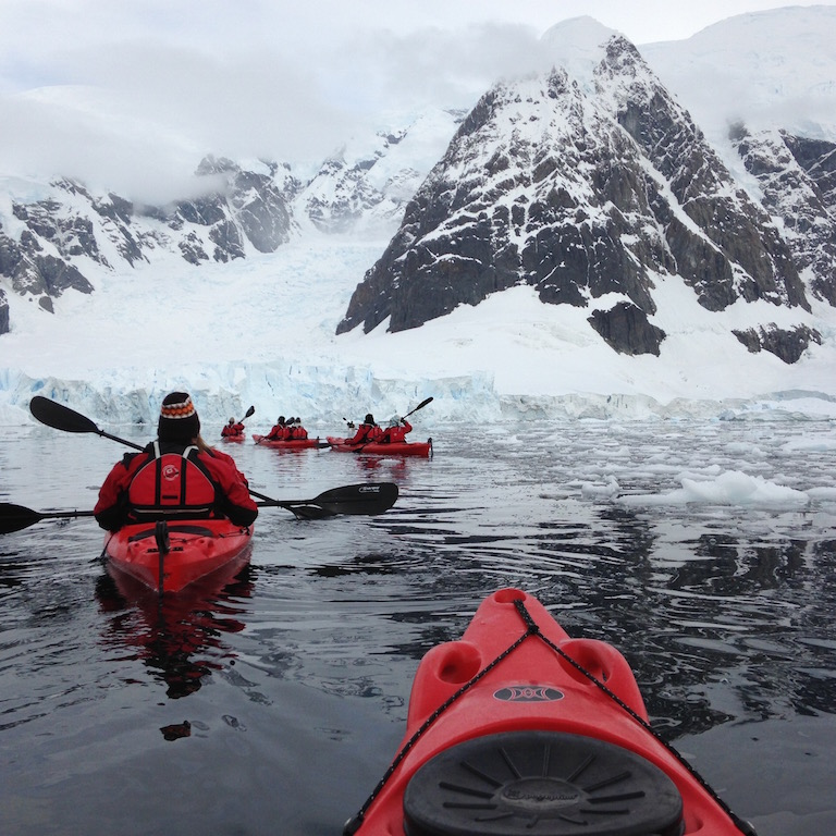Kayaking through the ice.