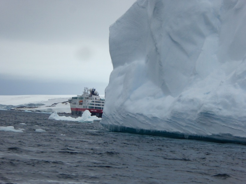 You can see the size of this iceberg compared to the ship behind it.