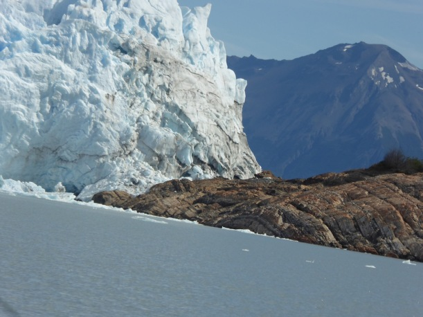 The glacier is near the land.