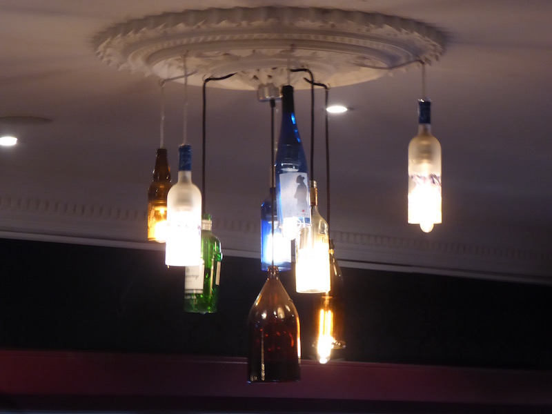 This light fixture is made out of beer bottles.