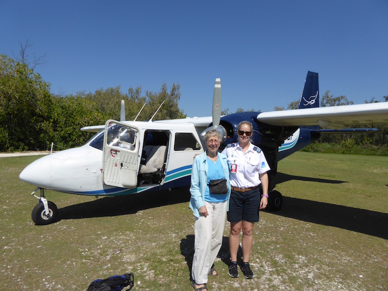 Nancy with the pilot of the plane.