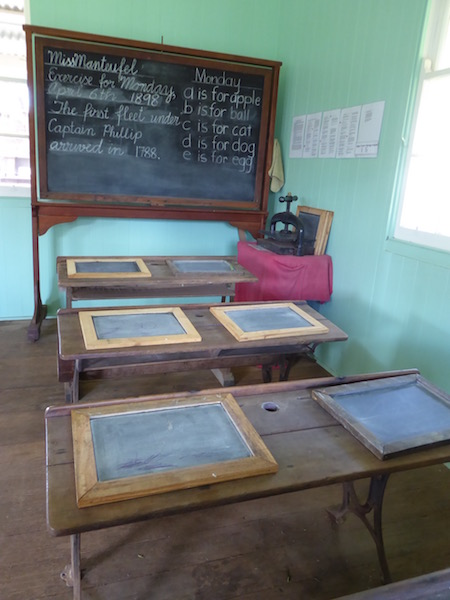 These are old school desks with slates on them.