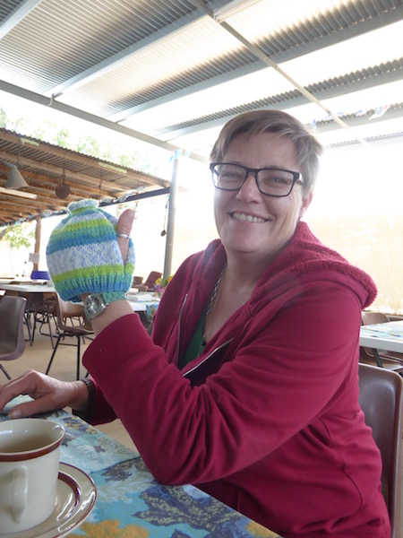This woman makes teapot covers.